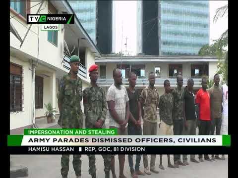 ARMY PARADES DISMISSED OFFICIALS, CIVILIANS