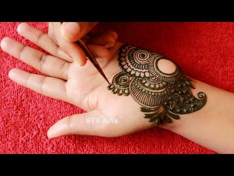beautiful semi bridal arabic mehndi design for front hand by 9t9 art