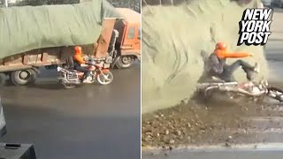 Motorcyclist narrowly avoids getting obliterated by a mountain of debris | New York Post