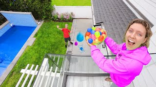 DROPPING 10,000 WATER BALLOONS ON STEPHEN SHARER!! (Family Vacation Prank)