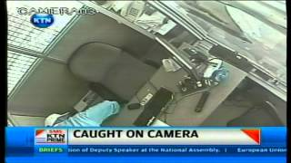 Armed robbers stealing from a chemist