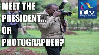 President Uhuru tries photography as he leads staff in tree-planting exercise