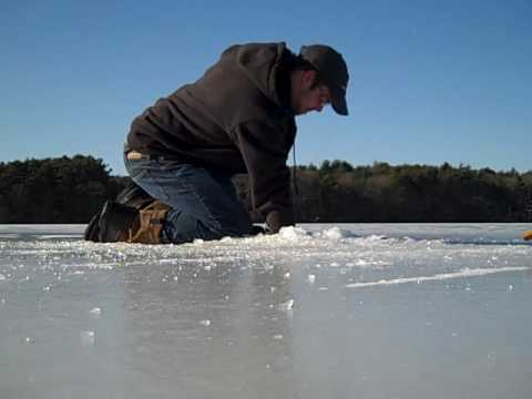ice fishing, broodstock atlantic salmon, little pond, plymouth, MA.