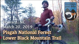 Riding down Lower Black Mountain in Pisgah National Forest on a dropbar trail bike.