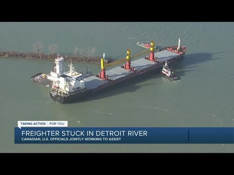 Canadian and US officials are working to get a stuck freighter free in the Detroit river
