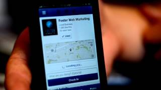 How do I update my Facebook business profile from my iPhone?