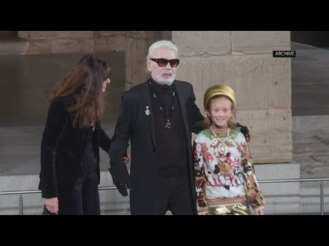 Chanel's iconic couturier, Karl Lagerfeld, whose accomplished designs as well as trademark white ponytail, high starched collars and dark enigmatic glasses dominated high fashion for the past 50 years, has died. (Feb 19)
