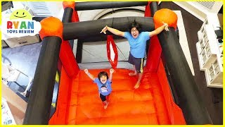 Giant Inflatable bounce House playground with Slides in our living room!!! Then we play with the bounce bounce outside! Fun outdoor playground too with Ryan ToysReview!!!