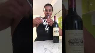 How to open a bottle of wine using a winged corkscrew.