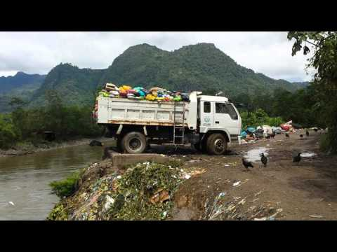 Plastic rubbish being dumped into the amazon river