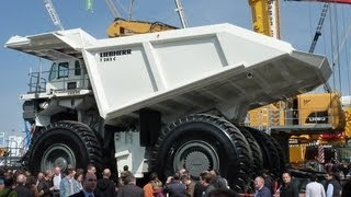 preview picture of video 'Giant Liebherr T282C Mining Truck Demo @ Bauma 2010'