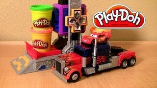 This is play doh Transformers Autobot Workshop play set from Dark of the Moon with bumblebee, Ironhide, Megatron and Optimus Prime. Roll cars into the workshop and watch as they transform into robots! This playset comes with 4 cans, 4 car molds and sculpting tools to help build your favorite Transformers Best of all with this set you can transform your Disney Pixar play-doh cars into autobots. In this video i'm transforming Cars 2 Lightning McQueen, Raoul Caroule and Francesco Bernoulli into robots. Thanks for watching my car-toys reviews by blucollection.  Thanks for watching BluToys channel. Great News! John Lasseter, the director of Cars has announced Pixar is working on a Cars3 film for 2018. Story is about town of Radiator Springs and Route 66. Check out my new 2014 Play-Doh Playlist.   Thanks for watching ToyCollector Blucollection. I'm an avid DisneyToyCollector collecting everything about Disneytoys and PixarCars for over 10 years. This is a Brazilian ToyChannel dedicated to review juegos juguetes giocattoli y brinquedos de carrinhos. Please subscribe!  Play-Doh Transformers Autobot Workshop Playset by BluToys. https://www.youtube.com/watch?v=wZINpnFAiUA  Popin' Cookin' GUMMY BEARS by おえかきグミランド Gummi-Land. https://www.youtube.com/watch?v=TG-qYSt4XiI  10 Cars Race Launcher World Grand Prix Speedway Multilanzadera. https://www.youtube.com/watch?v=SHiq1-PP7c0  Monster Screaming Banshee Eating Cars Snot Rod Tunerz. https://www.youtube.com/watch?v=wWnWQcfAi1M  Monster-Truck Gear Up n go Lightning McQueen https://www.youtube.com/watch?v=oQiGfOjFpls  3PixarCars Funny Talkers Snot rod, Mcqueen & Mater. https://www.youtube.com/watch?v=DSf05hcY0BI  Pocoyo Swiggle Traks Pixar Cars RadiatorSprings500. https://www.youtube.com/watch?v=_dhriJvP_r4  Pocoyo Swiggle Traks Motorized Juguete de Coches. https://www.youtube.com/watch?v=zV7xT77EX50  Pocoyo Circuit Race Track - Supercircuito Pista de Corridas. https://www.youtube.com/watch?v=bc8rjYUx-rs  4 Pocoyo Bath Toys Fun Traceables Loula Elly Elephant. https://www.youtube.com/watch?v=moZZChfsB6c  Pocoyo School Blocks Building Toys Similar to Lego Bloks. https://www.youtube.com/watch?v=ZsuMonsSTmY  Play Doh Pocoyo Superman Man of Steel - Plastilina. https://www.youtube.com/watch?v=bs4EeXlYJsk  PixarCars2 Garage Storage Carry Case - Stores 33 Cars. https://www.youtube.com/watch?v=Nt09LF3lCSc  T-Rex Takedown Dinosaur Chomposaurus Eats McQueen. https://www.youtube.com/watch?v=XMxcEk31RhU  Cars2 Klip-kitz Juguete de coches Quebra-Cabeças. https://www.youtube.com/user/Blucollection  Check out DisneyCollector Toychannel about DisneyPlayDoh at: http://www.youtube.com/DisneyCollectorBR