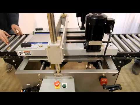 Selladora L-Clip para sellar cajas en la parte inferior con cinta adhesiva