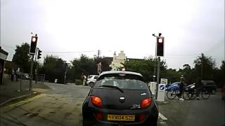 preview picture of video 'Idiot on the Road 42 - Cyclist Bump Into Each Other Avoiding Car'