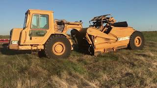 How to drive and grease a scraper CAT 613C