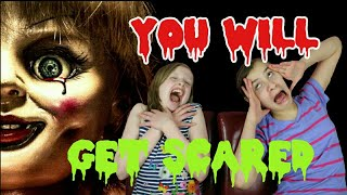 CUTE LITTLE GIRL GETS TERRIFIED BY EYE POPPING PARANORMAL ACTIVITY FOOTAGE SCARED CHALLENGE!
