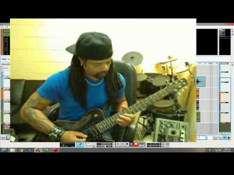 Prophet recording a Rock meets Hip Hop style beat with live guitars.