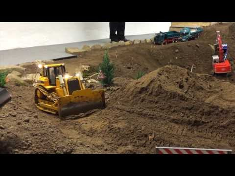 Building a miniature road with miniature equipment. Very relaxing to watch and visually informative!