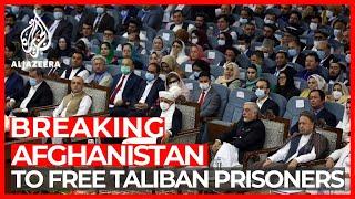 Afghan President Agrees Taliban Prisoner Release