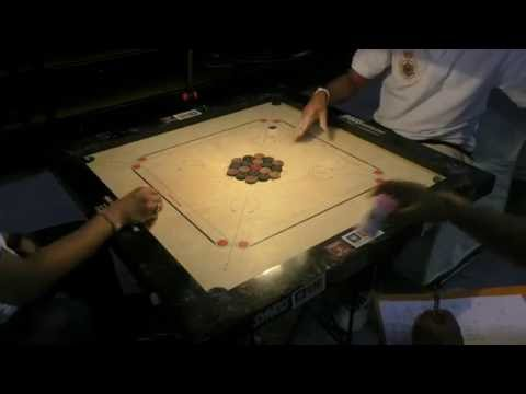 """Two masters duel to the last play in the Asian board game """"Carrom"""""""