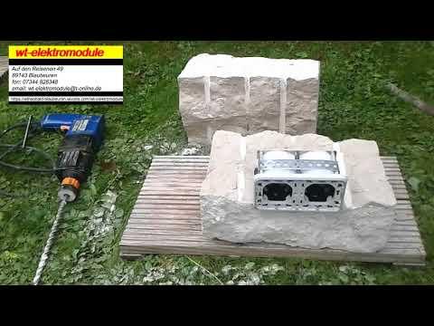 Schalter und Steckdose in Trockenmauer