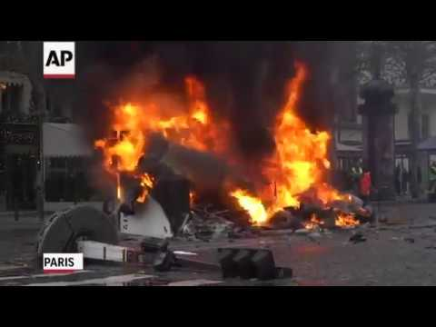 French police fired tear gas and water cannons to disperse demonstrators in Paris on Saturday, as thousands gathered in the capital and beyond and staged road blockades to vent anger against rising fuel taxes. (Nov. 24)