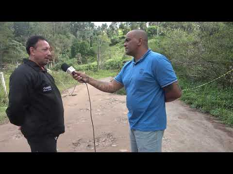 Marco Antonio da Defesa Civil de Juquitiba reza apara não chover mais próximo a Represa do Calazan
