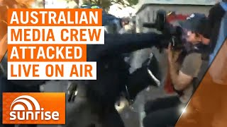 7NEWS US Correspondent Amelia Brace and cameraman Tim Myers have been caught up in a stampede as police violently cleared an anti-racism protest in Washington D.C. Shocking video broadcast live on Australian breakfast news program 'Sunrise' shows a police officer in riot gear bashing Myers with a shield before punching the camera.  Subscribe to 7NEWS for the latest video » https://7news.link/YTSubscribe  Connect with 7NEWS online Visit » https://7news.com.au Facebook » https://www.facebook.com/7NewsAustralia Twitter » https://twitter.com/7NewsAustralia Instagram » https://www.instagram.com/7newsaustralia/   7NEWS combines the trusted and powerful news brands including Sunrise, The Morning Show, The Daily Edition, The Latest, and 7NEWS.com.au, delivering unique, engaging and continuous coverage on the issues that matter most to Australians. Watch 7NEWS nightly at 6pm and weekdays at 11:30am and 4pm on Channel 7 and 7plus.  #BreakingNews #Washington #7NEWS
