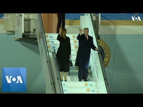 President Trump and first lady arrive in France