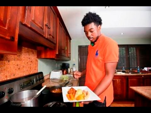 IN THE KITCHEN: Devin Di Dakta serves stewed chicken