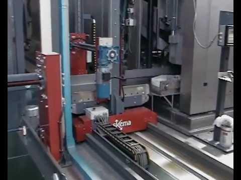 Skema srl - LN.01 - Impianto di smistamento biancheria presse/essicc. Shuttle (1201.1)