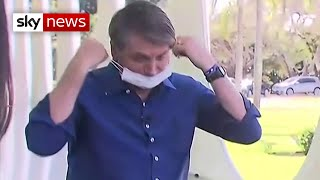 Bolsonaro takes off mask while announcing he tested positive for COVID-19