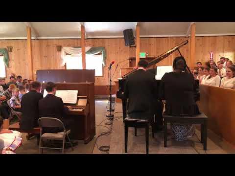 Joseph performs with faculty an original piano quartet composition at the Washington piano seminar in 2018.