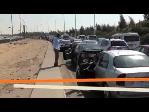 الوطن| موكب مرسي يعطل الدائرى والسائقون يهددون بقطع الطريق