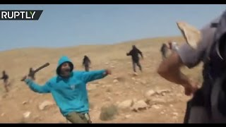 Masked Israeli settlers attack activists with stones & clubs in West Bank