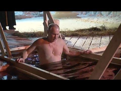 b1bebc8a18c Ο Πούτιν βούτηξε σε παγωμένα νερά Λίμνης για τα Θεοφάνεια και έκανε το  σταυρό του