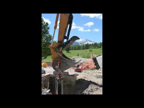 YSS was contacted by the general contractor of this project to consult and install a total quantity of 22 FSI Model 288 push piers in eight concentrated load zones throughout the existing foundation. The original home was demolished and a new contemporary home was designed and scheduled for construction. The new home had a roof pitch of 1.5/12 in an area with a snow load potential of 200 psf. Push piers were specified by the design engineer to reinforce areas of the salvaged foundation in order to support the increased loads. YSS had to be innovative in this project as push piers require a reactive force equal to or greater than the ultimate installation force. Considering that the greater structure was now gone, a temporary load was required for a successful installation. YSS requested that a 20-ton excavator be available on-site to provide this temporary load at each point of installation. The plan was executed perfectly and the piers were installed in five days.