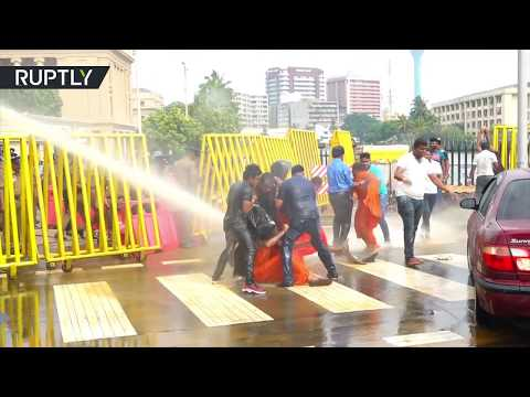 Protesting Buddhist monks battle water cannon & teargas in Sri Lanka