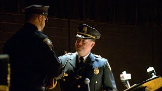 Peter Reichard is sworn in as the New London Chief of Police