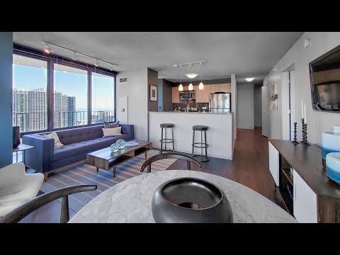 A Lakeshore East -09 2-bedroom with a wraparound balcony at Aqua