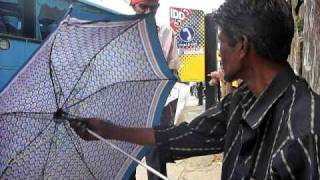 preview picture of video 'Sri Lanka,ශ්‍රී ලංකා,Ceylon, Kandy : Umbrella Repair Man'
