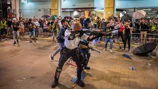 video: Hong Kong protesters clash with police as 44 activists charged with rioting
