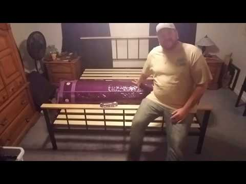 Unpacking a king size purple mattress.