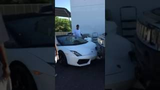 Hummer crashes into a parked Lamborghini