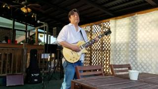 "Jimmy Lee, playing ""Winter of 1996"" at Epicure Cafe."