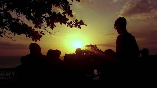 Silhouette Walking People At Sunset Beach Of Batu Bolong Temple At Tanah Lot Tabanan Bali Indonesia