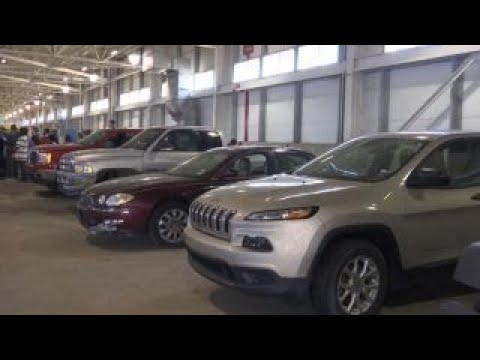 Airport auctions off lost and found items, abandoned cars