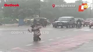 Odisha Homeguard Mans Crossing Despite Heavy Rains In Bhubaneswar