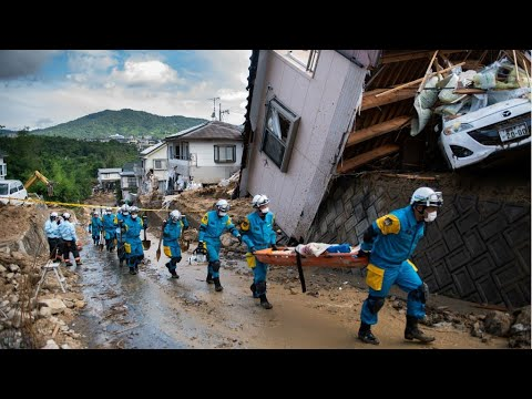 Japan races to find survivors as floods kill at least 100