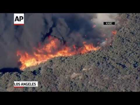 A raging Southern California wildfire has moved into Griffith Park, in Los Angeles, and near the the Los Angeles Zoo Friday morning. (Nov. 9)